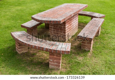 Benches made of stone on the lawn. - stock photo