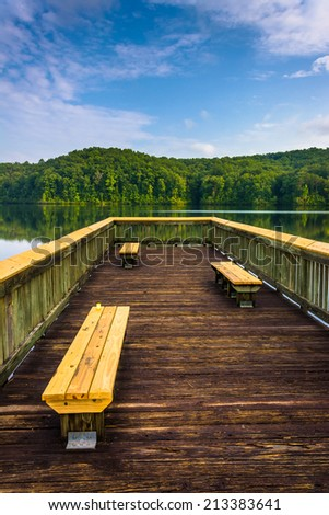 Benches on a small pier at Lake Oolenoy, Table Rock State Park, South Carolina. - stock photo