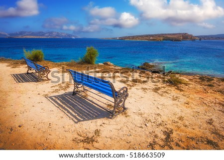 Benches overlooking a beach on Pano Koufonisi island, Greece