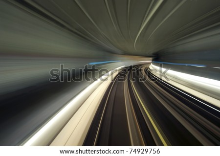 Bend in a subway tunnel, seen from the cockpit using a long exposure - stock photo