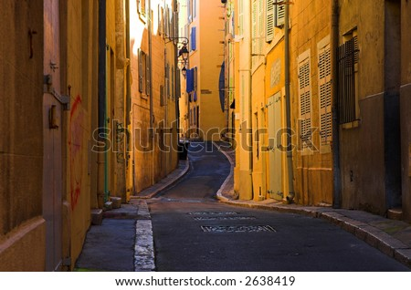 Bend streets in the old port part of Marseille, France - stock photo