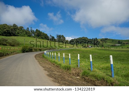 Bending road in inland  Costa Rica highlands - stock photo