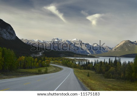Bending road winding through mountains - stock photo