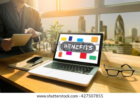 BENEFITS Thoughtful male person looking to the digital tablet screen, laptop screen,Silhouette and filter sun - stock photo