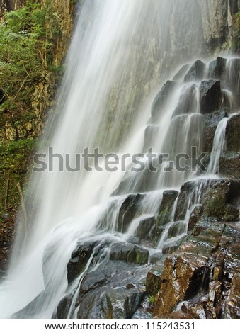 Benevskoy Waterfall on Elomovsky Spring in the russian Lazovsky Reserve. Fragment - stock photo