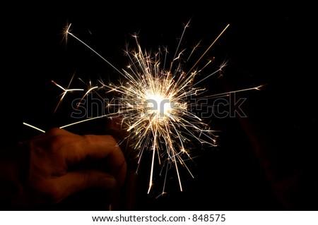 Bengal light (cascade of sparks) - stock photo