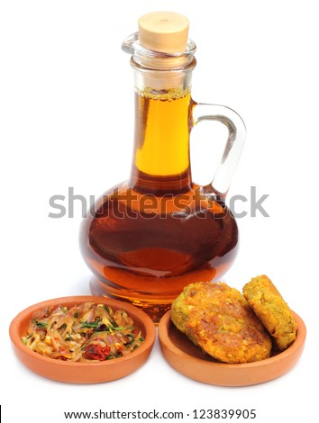 Bengali Cuisine � Mustard onion salad and lentil chop with mustard oil - stock photo