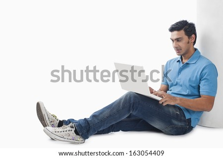 Bengali man using a laptop
