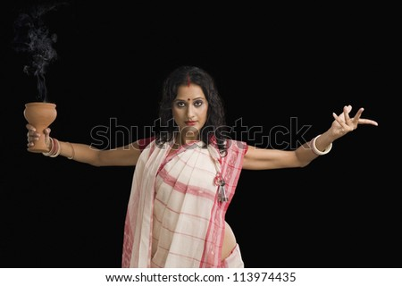 Bengali woman performing ritual dance - stock photo