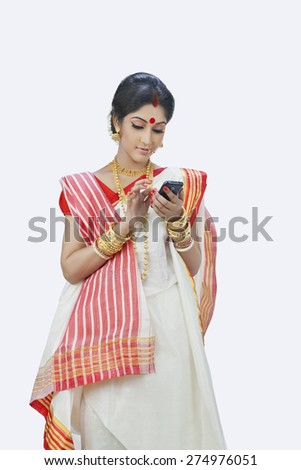 Bengali woman typing message on mobile phone - stock photo