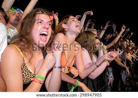 BENICASSIM, SPAIN - JUL 17: Girls from the first row in a concert at FIB Festival on July 17, 2015 in Benicassim, Spain.