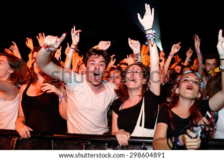 BENICASSIM, SPAIN - JUL 16: People from the audience what a concert at FIB Festival on July 16, 2015 in Benicassim, Spain. - stock photo