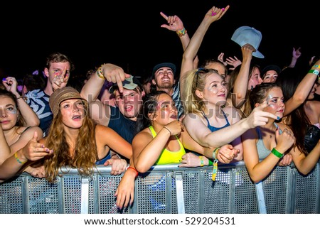 BENICASSIM, SPAIN - JUL 14: The crowd in a concert at FIB Festival on July 14, 2016 in Benicassim, Spain.