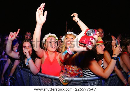 BENICASSIM, SPAIN - JULY 17: Crowd in a concert at FIB Festival on July 17, 2014 in Benicassim, Spain.