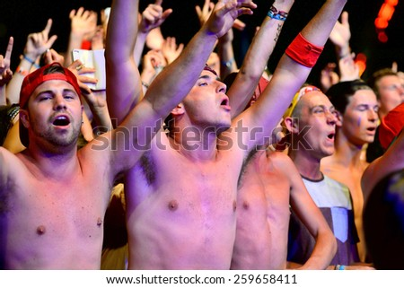 BENICASSIM, SPAIN - JULY 19: Crowd in a concert at FIB Festival on July 19, 2014 in Benicassim, Spain. - stock photo