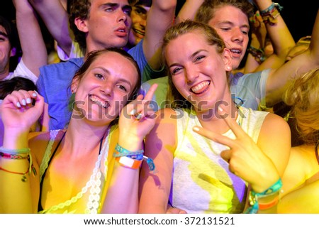 BENICASSIM, SPAIN - JULY 17: Girls from the crowd in a concert at FIB Festival on July 17, 2014 in Benicassim, Spain.