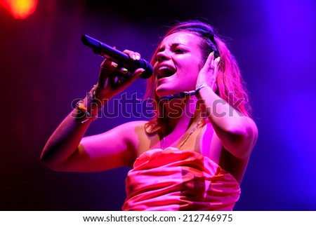 BENICASSIM, SPAIN - JULY 19 Lily Allen (singer, songwriter, musician, actress and television presenter) performs at FIB Festival on July 19, 2014 in Benicassim, Spain. - stock photo