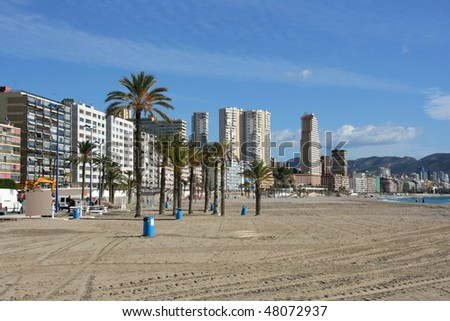 Benidorm - city of skyscrapers next to Mediterranean beach. Spain in November.