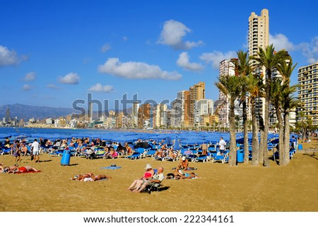 BENIDORM, SPAIN - SEPTEMBER 23: Vacationers in Levante Beach on September 23, 2014 in Benidorm, Spain. Benidom, called sometimes Beniyork, is a major destination for sun and beach for European tourism - stock photo