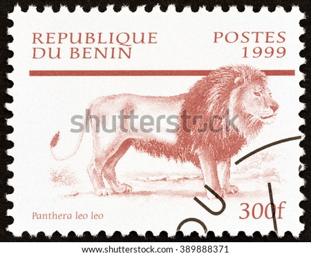 """BENIN - CIRCA 1999: A stamp printed in Benin from the """"Mammals """" issue shows Lion (Panthera leo), circa 1999.  - stock photo"""