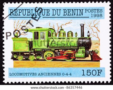 BENIN - CIRCA 1998:  A stamp printed in Benin shows an old railroad steam engine locomotive made by Warrenton, circa 1998. - stock photo