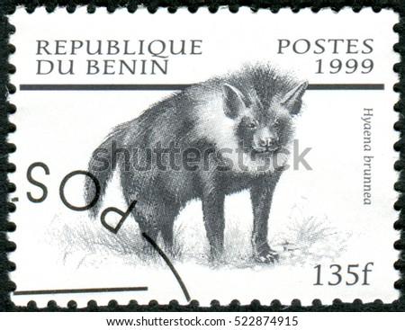 BENIN - CIRCA 1999: A stamp printed in Benin, shows the Brown Hyena (Hyaena brunnea), circa 1999