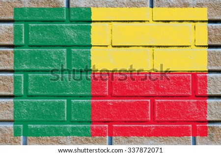 Benin flag painted on old brick wall texture background - stock photo