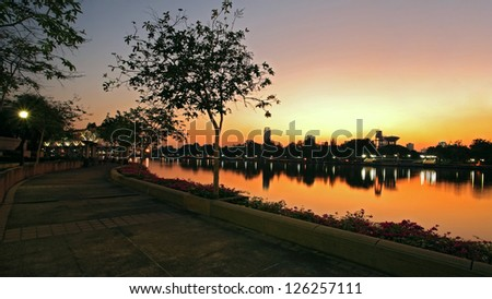 Benjakitti park with cityscape during twilight in Bangkok, Thailand - stock photo