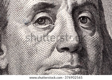 Benjamin Franklin, a close-up portrait on US hundred dollars  - stock photo