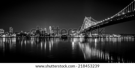 Benjamin Franklin Bridge by night from new jersey side. - stock photo