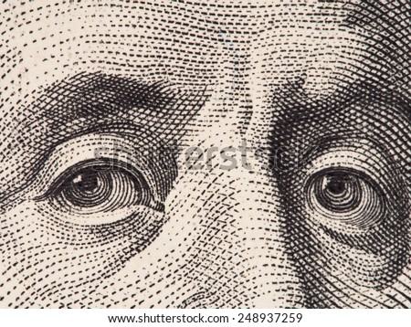 Benjamin Franklin eyes extreme macro on us 100 dollar bill, united states money closeup - stock photo