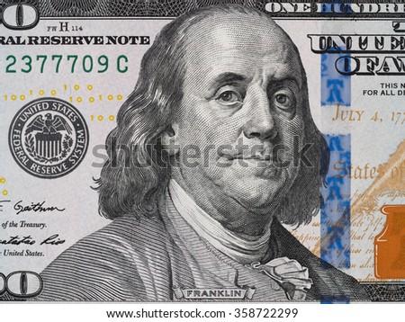 Benjamin Franklin face on us one hundred dollar bill macro, united states money closeup - stock photo