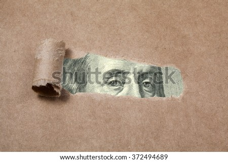Benjamin franklin on tear paper, closeup image, concept - stock photo