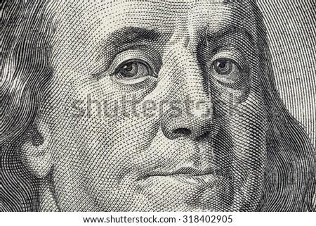 Benjamin Franklin's face on the US 100 dollar bill - stock photo