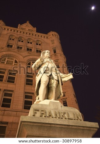 Benjamin Franklin Statue Old Post Office Building Pennsylvania Ave Washington DC with moon in the background - stock photo
