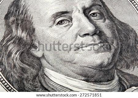 Benjamin looking at you on money. Stacked macro photo. - stock photo