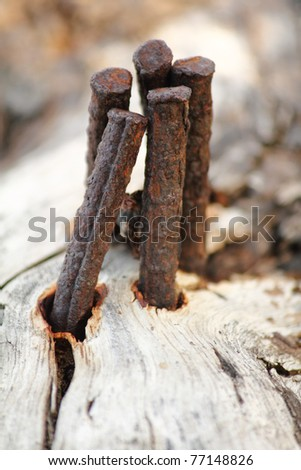 Bent iron bars leaning towards each other - stock photo