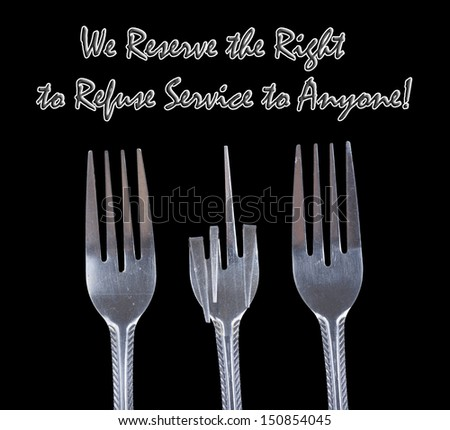 Bent metal fork isolated on black background. We reserve the right to refuse service to Anyone concept. Different shapes and concepts are available in the set. - stock photo