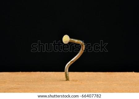 Bent nail - stock photo