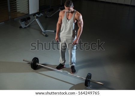 Bent Over Row Workout For Back. Man Doing Heavy Weight Exercise For Back - stock photo