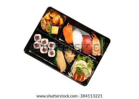 Bento box with sushi isolated on white background - stock photo
