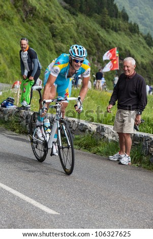 BEOST,FRANCE-JUL 15:A cyclist from Pro Astana Team,climbing the last kilometers of the category H mountain pass Aubisque, during the 13th stage of Le Tour de France on July 15 2011.