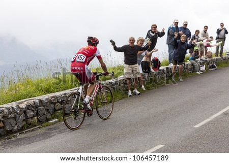 "BEOST,FRANCE-JUL 15:The cyclsit David Moncutie (Cofidis team) climbing the mountain pass Aubisque, during the 13 stage of ""Le Tour de France"" on July 15 2011. - stock photo"