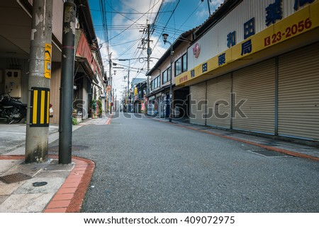 Beppu, Japan - September 28, 2014: Street near Beppu station in the morning. Beppu is a city located in Oita Prefecture on the island of Kyushu, Japan.