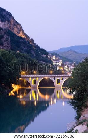 Berat: the bridge that links neighborhoods Gorica (side christian) and Mangalem (side musulman) at the twilight, Albania - stock photo