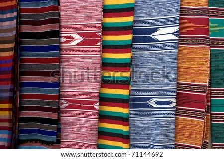 Berber culture - carpets and clothes found in morocco - stock photo