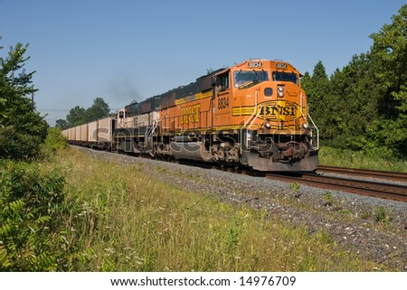 BEREA, OH - JUly 15: Burlington Northern Santa Fe Railroad locomotives haul empty coal hoppers returning to the Powder River Basin mining operations in Wyoming on July 15, 2008 at Berea, Ohio. - stock photo