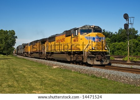 BEREA, OH - JUNE 16: A Union Pacific Freight Train travels east on CSXT tracks June 16, 2008 in Berea, Ohio. The Union Pacific railroad uses CSX Transportation track via a trackage rights agreement. - stock photo