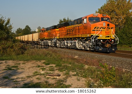 BEREA, OH - SEPTEMBER 22: Two GE Evolution Series ES44DC locomotives in Burlington Northern Santa FE livery pass through Berea, Ohio September 22, 2008 on their first revenue earning trip. - stock photo