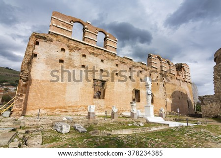"Bergama, Turkey - February 13, 2016 :  The ""Red Basilica"" (Kizil Avlu), also called  the Red Hall and Red Courtyard, is a monumental ruined temple in the ancient city of Pergamonin Berma, Turkey."